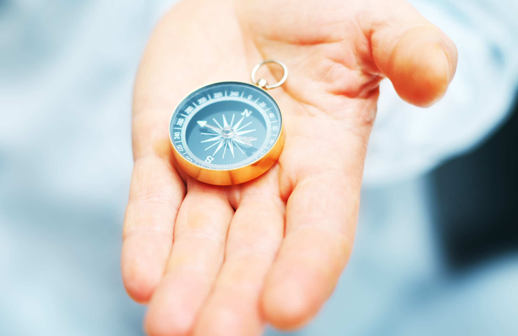 Image of compass in businessman hand